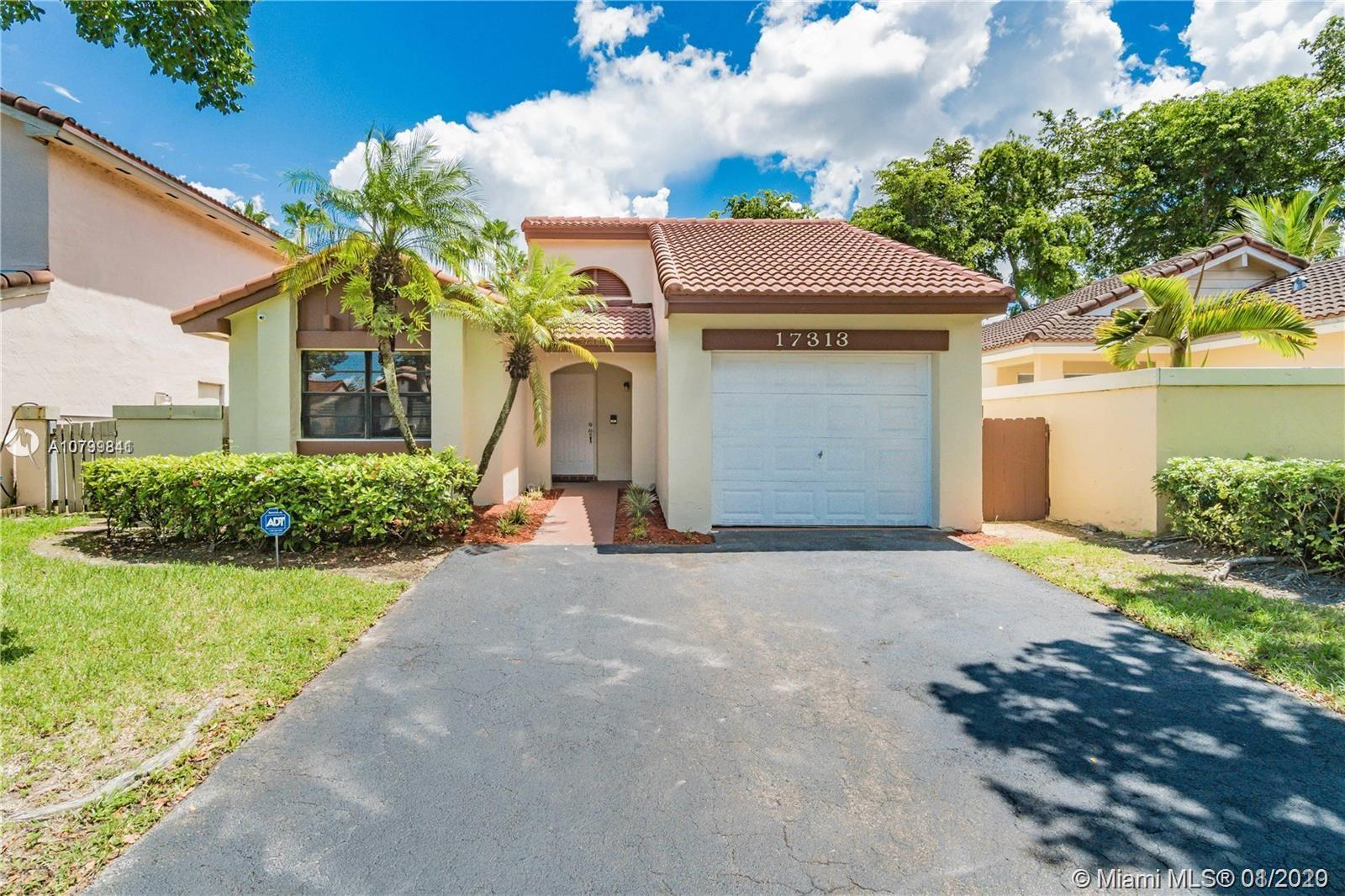 Lovely home located in the prestigious gate community of The Moors in Country club of Miami Lakes in
