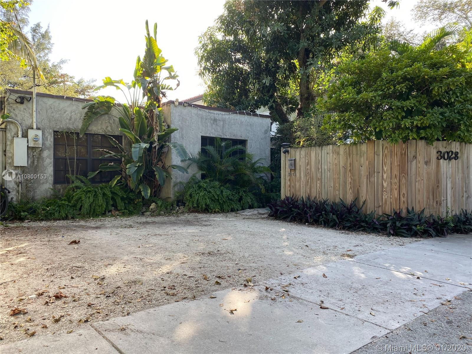 This unique property in the heart of the grove has great opportunity. Situate yourself directly acro