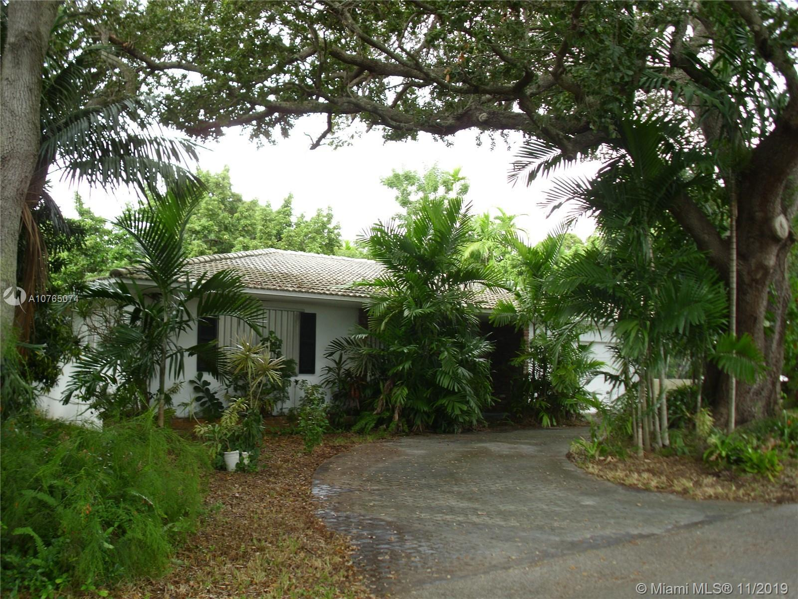 Spacious Miami Shores 3 bedroom 2 bath home with 2 car garage, & central air. Florida room and famil