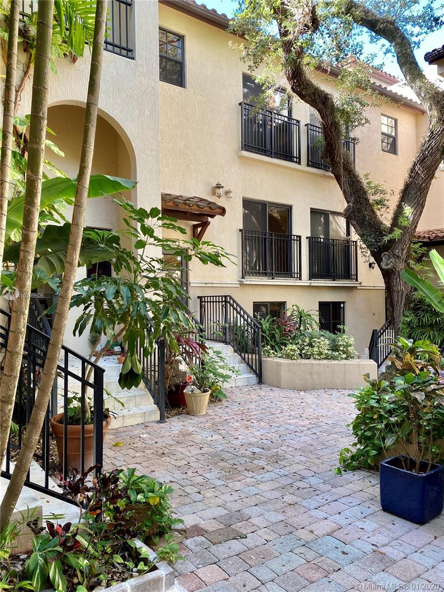 Tri-level Mediterranean style villa, beautiful enclosed courtyard entry. Features include: 2 bedroom