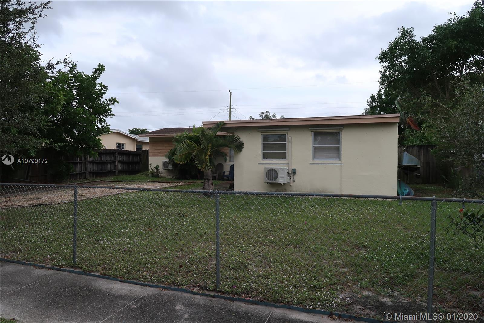 This is a three bedroom and two bathroom home located in the Driftwood Estates subdivision of Hollyw