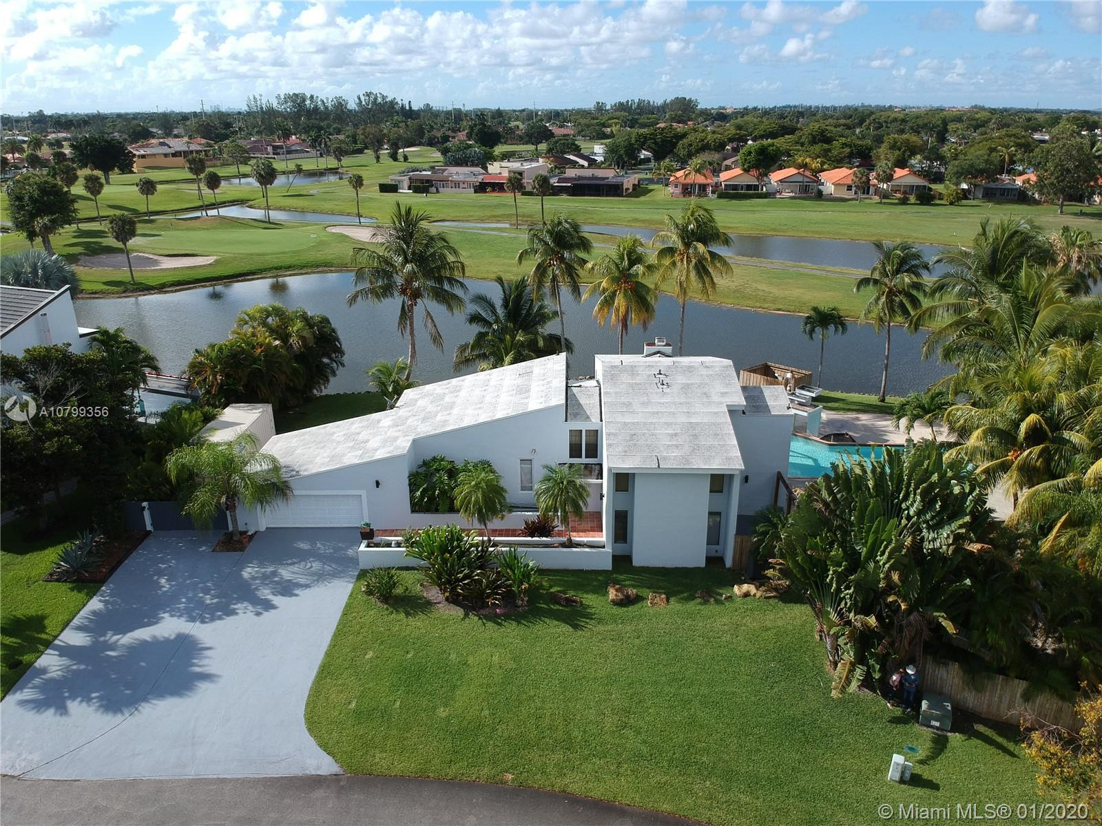 Great opportunity to own this unique 2 story lakefront home overlooking the Country Club Golf Course