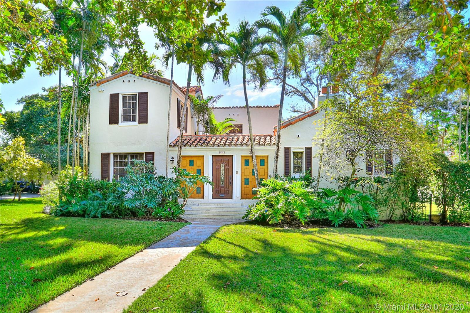 Charming Old Spanish home on the prettiest street in the Gables just steps from the Granada Golf Cou