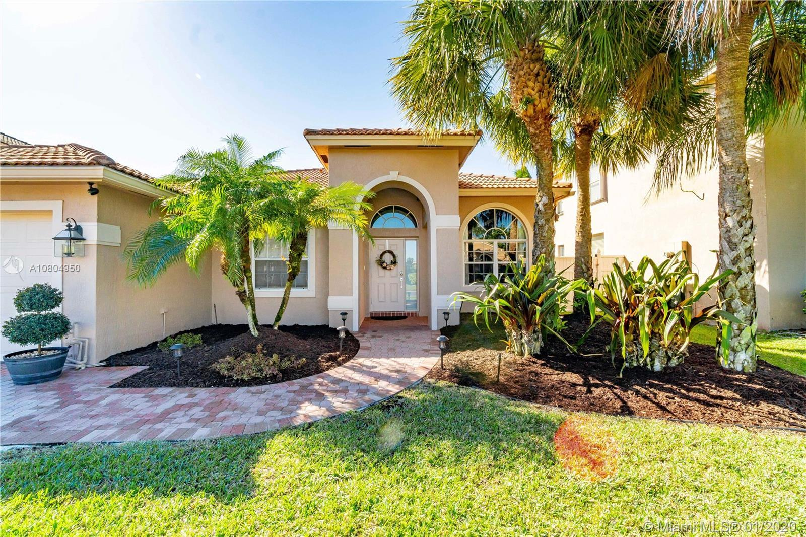 You will love this exquisite and captivating home in the prestigious Boca Winds community.  This hom