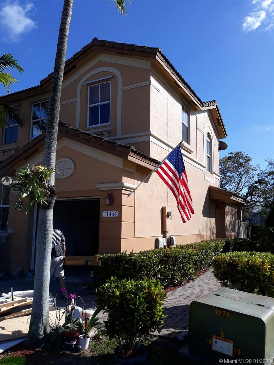 Beautiful corner townhouse with one car garage, 3 bedrooms 2 1/2 baths. Located in excellent gated c