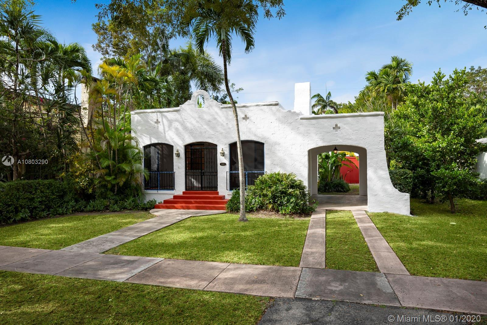 Be smitten by this adorable 2/1 + Den on tree-lined Madrid Street in Coral Gables. Freshly painted i