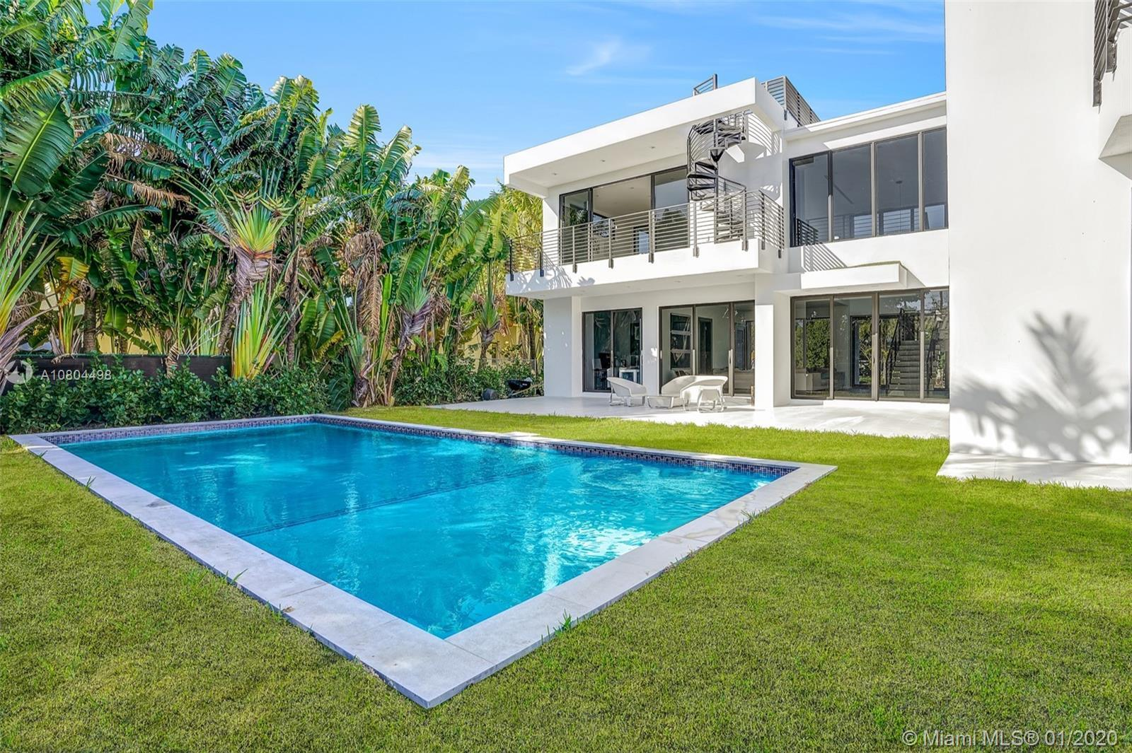Welcome to the Newest Modern home in a highly sought after Miami Beach area. Upon entry you are gree