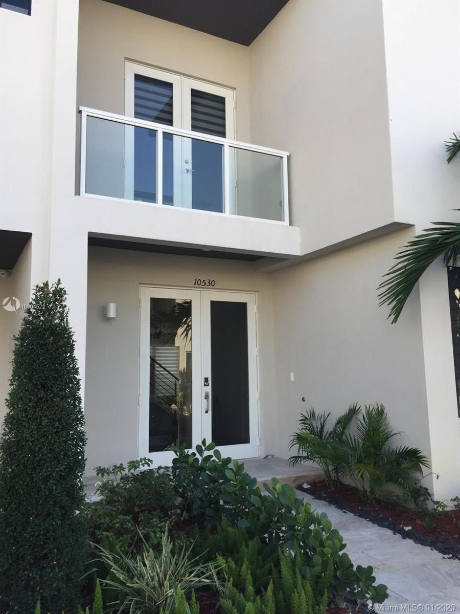 LUXURIOUS AND MODERN TWO STORY TOWNHOUSE 4 BEDS 3.5 BATHS, 2 CAR GARAGE AT THE DESIRABLE LANDMARK AT