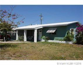 GREAT HOME IN UP AND COMING POMPANO BEACH-- MOSTLY UPDATED, 2 YEAR  OLD ROOF, IMPACT WINDOWS,3 BEDRO