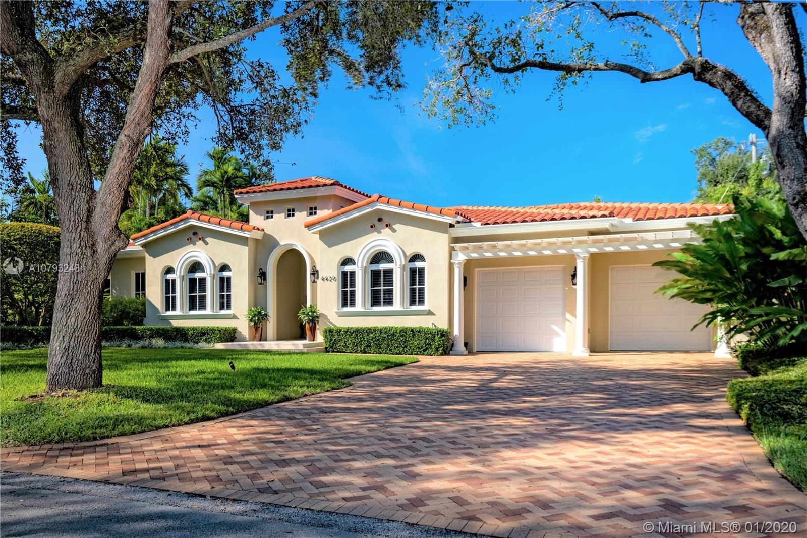 Executive living meets tropical haven! Move-in ready, single-story residence on coveted Coral Gables