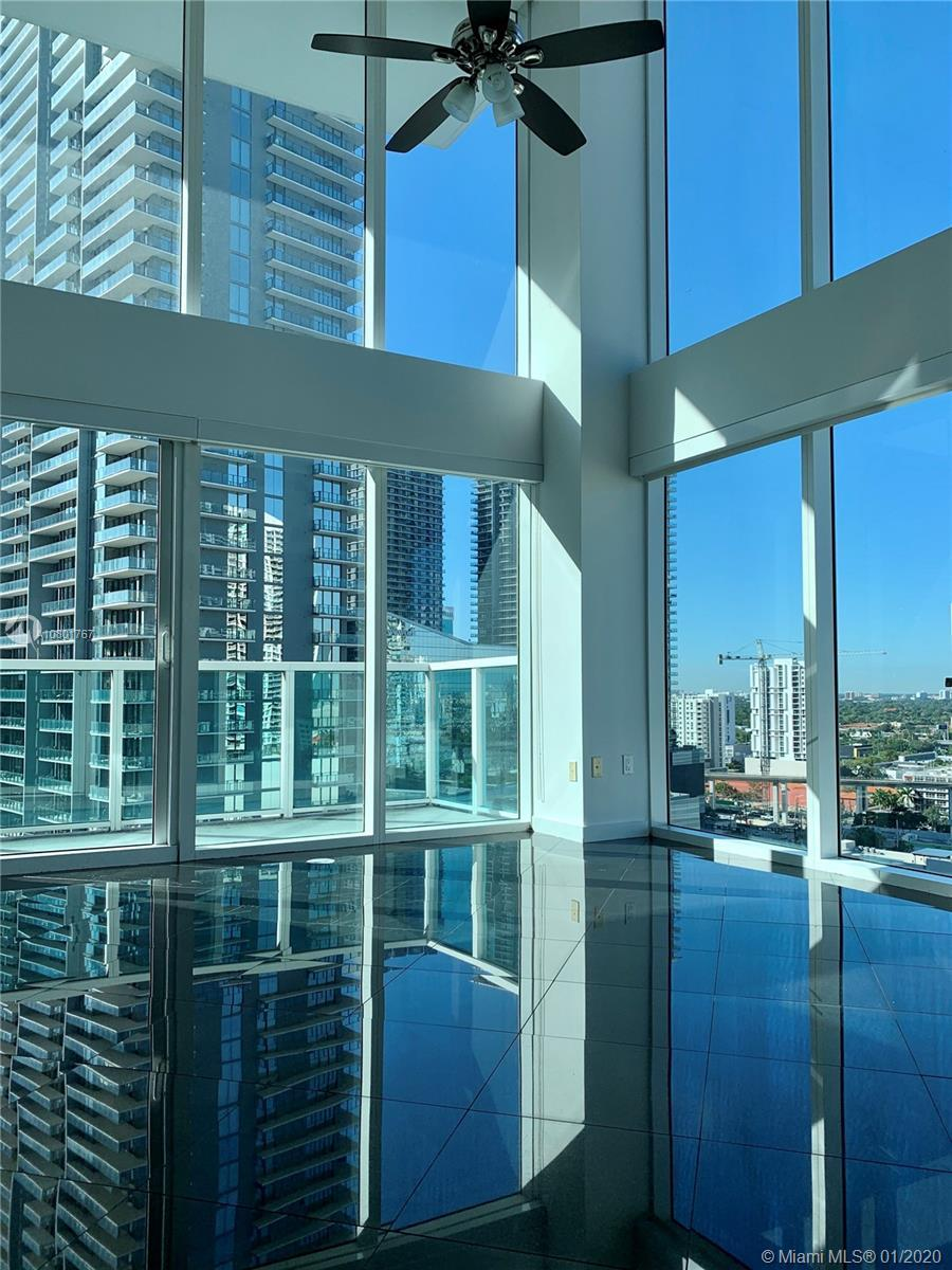 Beautiful, 2 story corner loft in Brickell On The River South. Gorgeous  river, sunset and city view