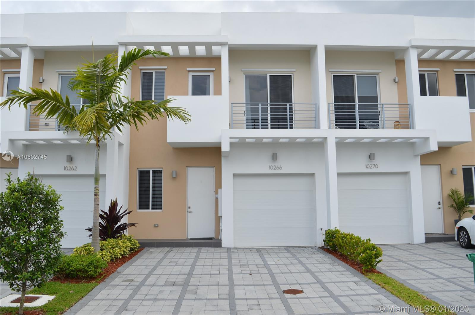 The highest level of modern architecture and design townhome in a gated community. Four (4) bedrooms