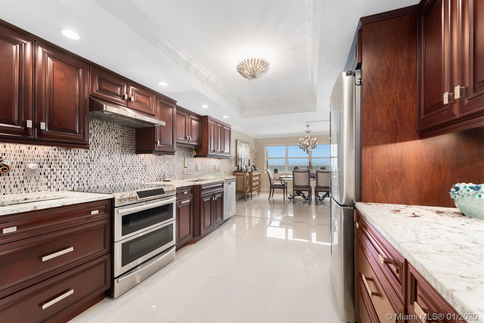 SPECTACULAR DIRECT OCEANFRONT VIEWS FROM THIS SPACIOUS 2 BEDROOM, 2.5 BATH CONDO. TILE FLOORS THROU