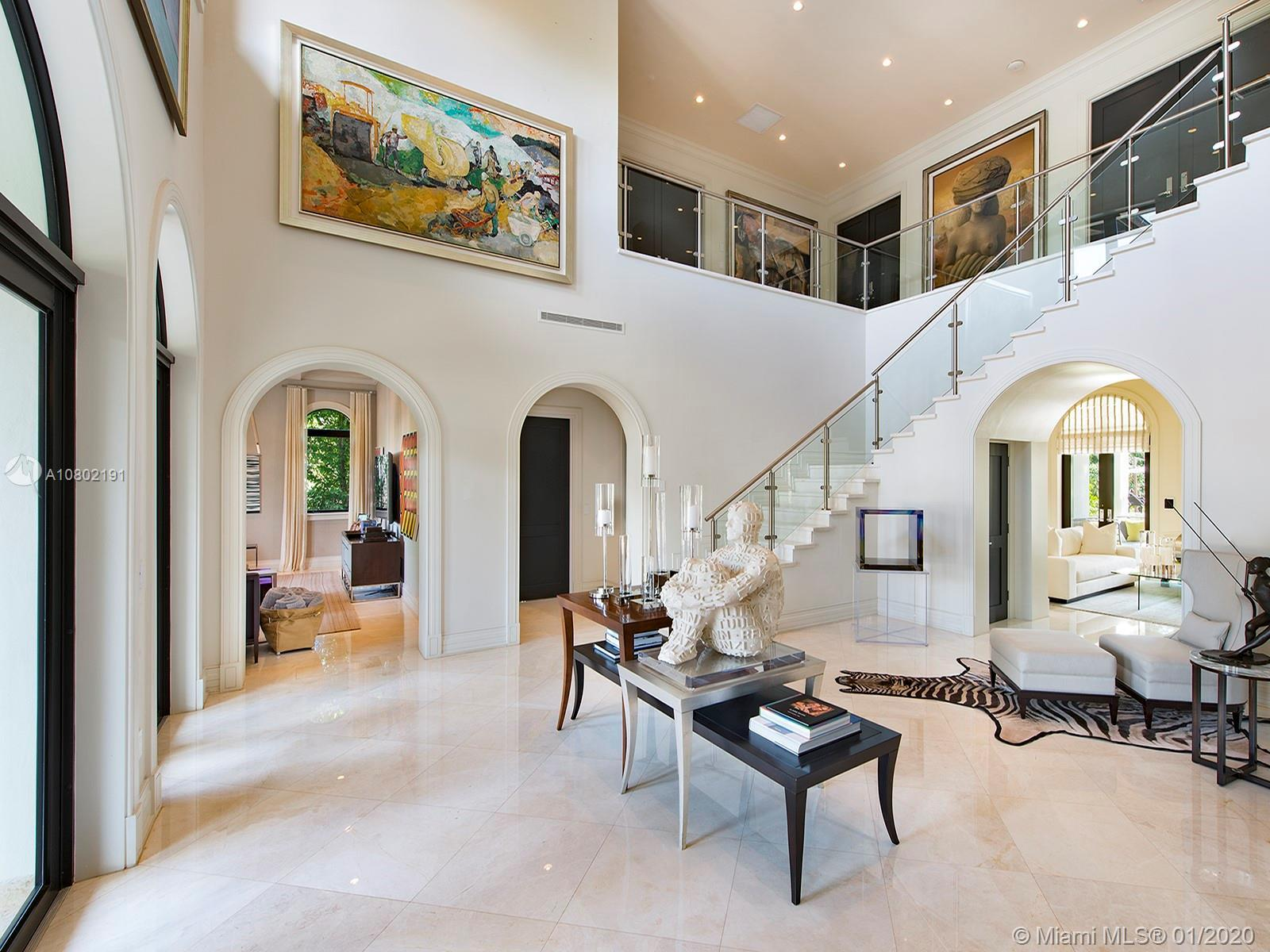 North Pinecrest Italianate Architecture Mansion!  This nearly 8,000 sq ft home has 8 bedrooms, 9.5 b