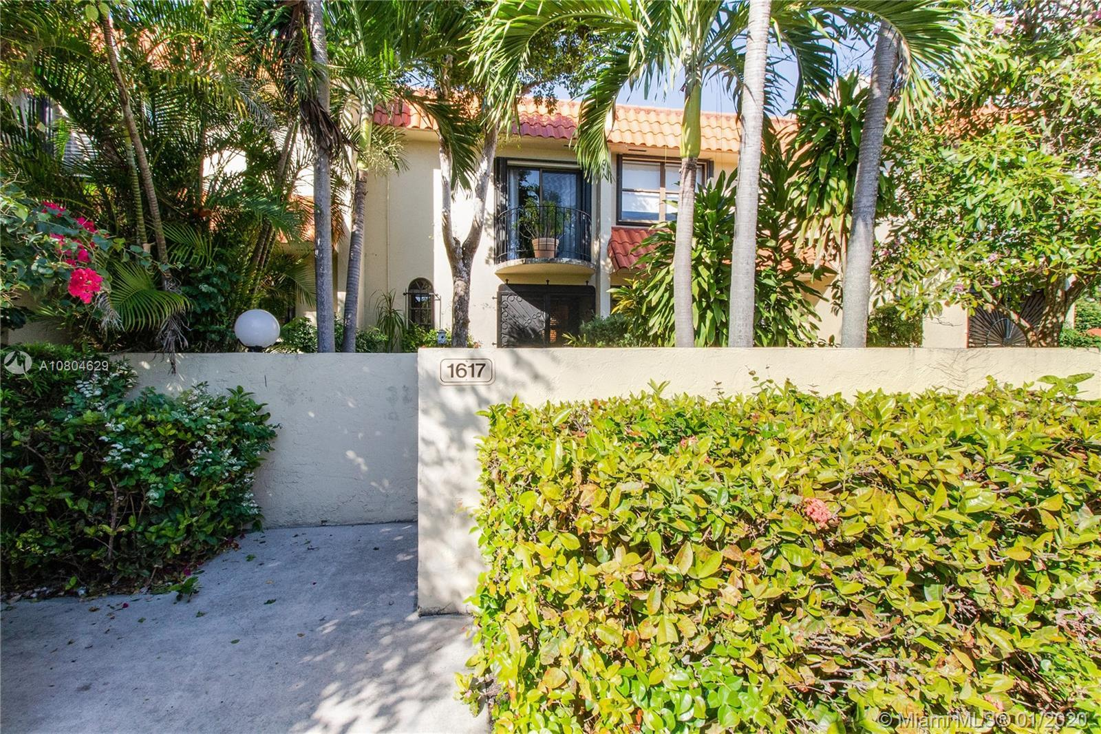 Meticulously maintained townhome located in beautiful Miami Shores!  This spacious townhome features