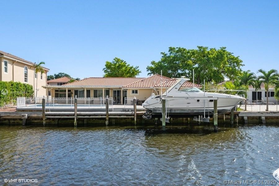 SOUTH FLORIDA LIVING AT ITS BEST! BOAT LOVER'S PARADISE- 85' FEET WATER FRONTAGE ON CANAL. QUICK AC