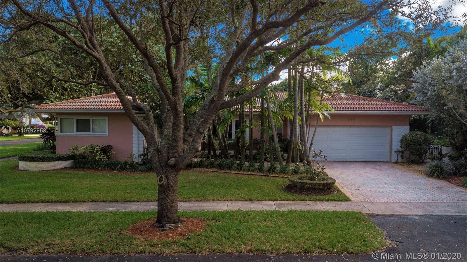 Three bedrooms and three full bathrooms East of US-1 in Miami Shores. Corner lot with koi pond,  scr