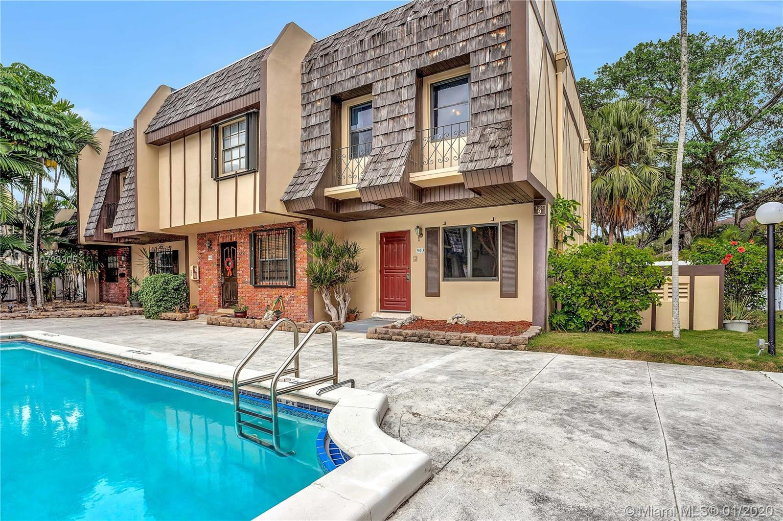 Poolside corner villa in South Miami with new open kitchen layout & stainless steel appliances. This