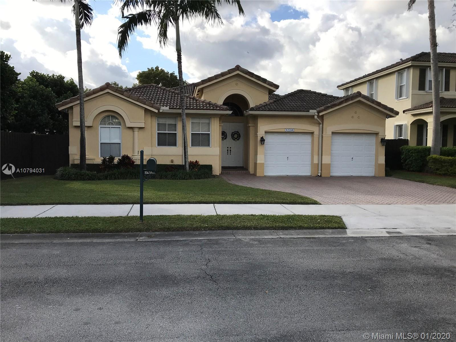 Kendall Breeze Single Family Home with 4 Bedrooms, 2 Bathrooms and a 2 Car Garage.Kitchen with Grani