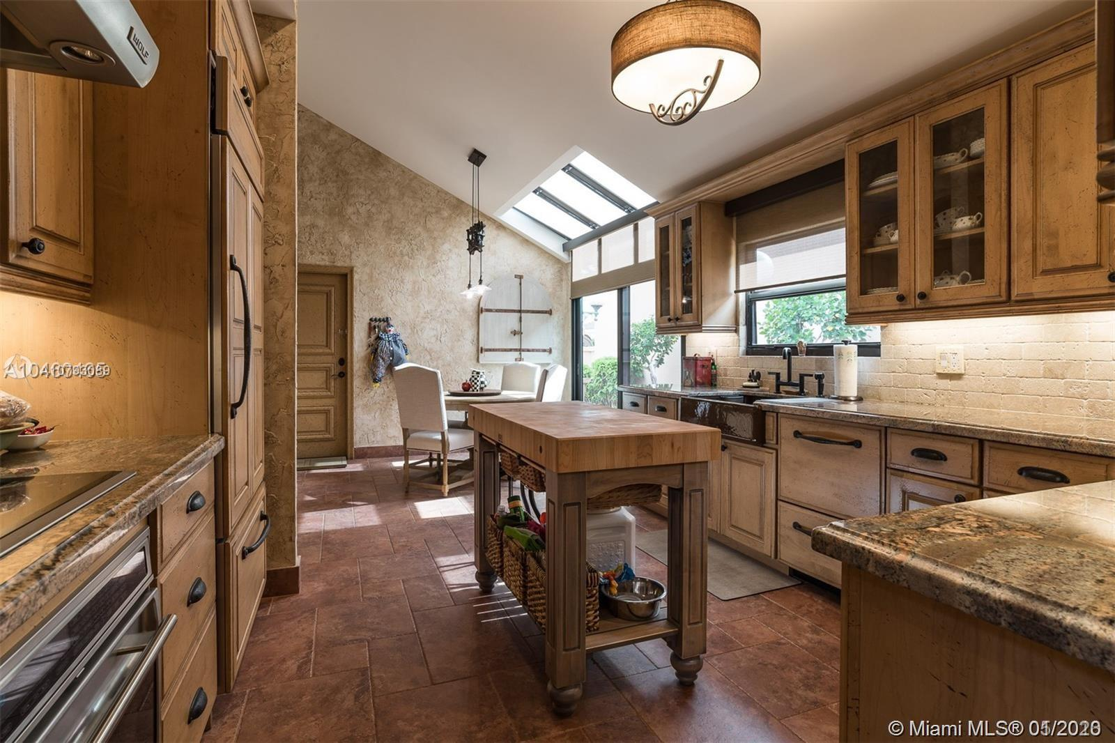 Captivating and spacious 2 bedroom, 2.5 bath turnkey home located within the peaceful Villa D' Este