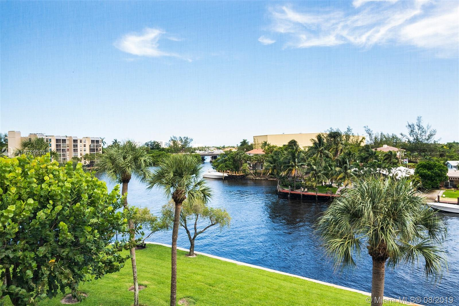 Waterfront living in East Boca Raton! Enjoy the most beautiful water view from your point lot balcon
