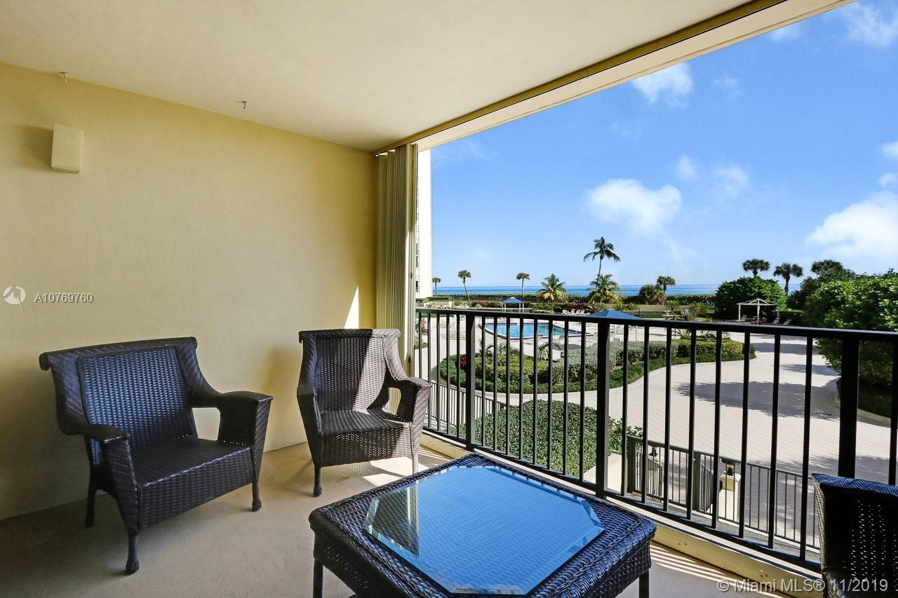 Fabulous community right on the beach! Second floor corner unit with ocean views. Furnishings negoti