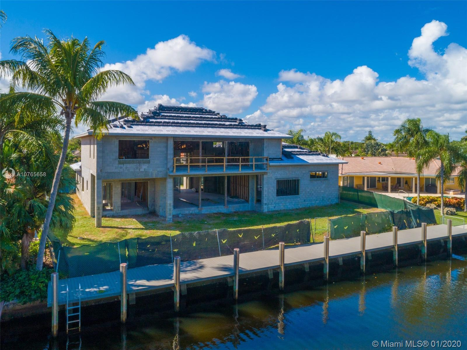 This BRAND NEW transitional modern deepwater estate sits on an oversized 12,000sf lot with 100ft of