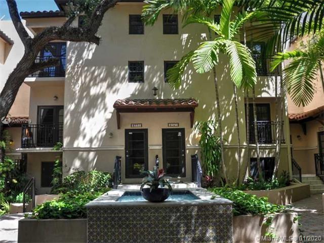 Mediterranean-style Tri-level townhouse condominium in gated community in Coconut Grove built in 200