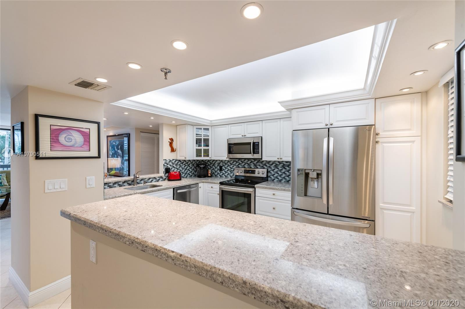 SOUTH FACING LARGE AND COMPLETELY REMODELED UNIT WITH SPLIT FLOOR PLAN AND INTRACOASTAL AND POOL VI