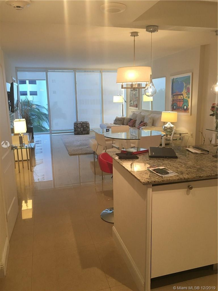 GORGEOUS AND FULLY REMODELED ONE BED IN PRESTIGIOUS HARBOUR HOUSE CONDO. STUNNING OCEAN VIEW. FULLY