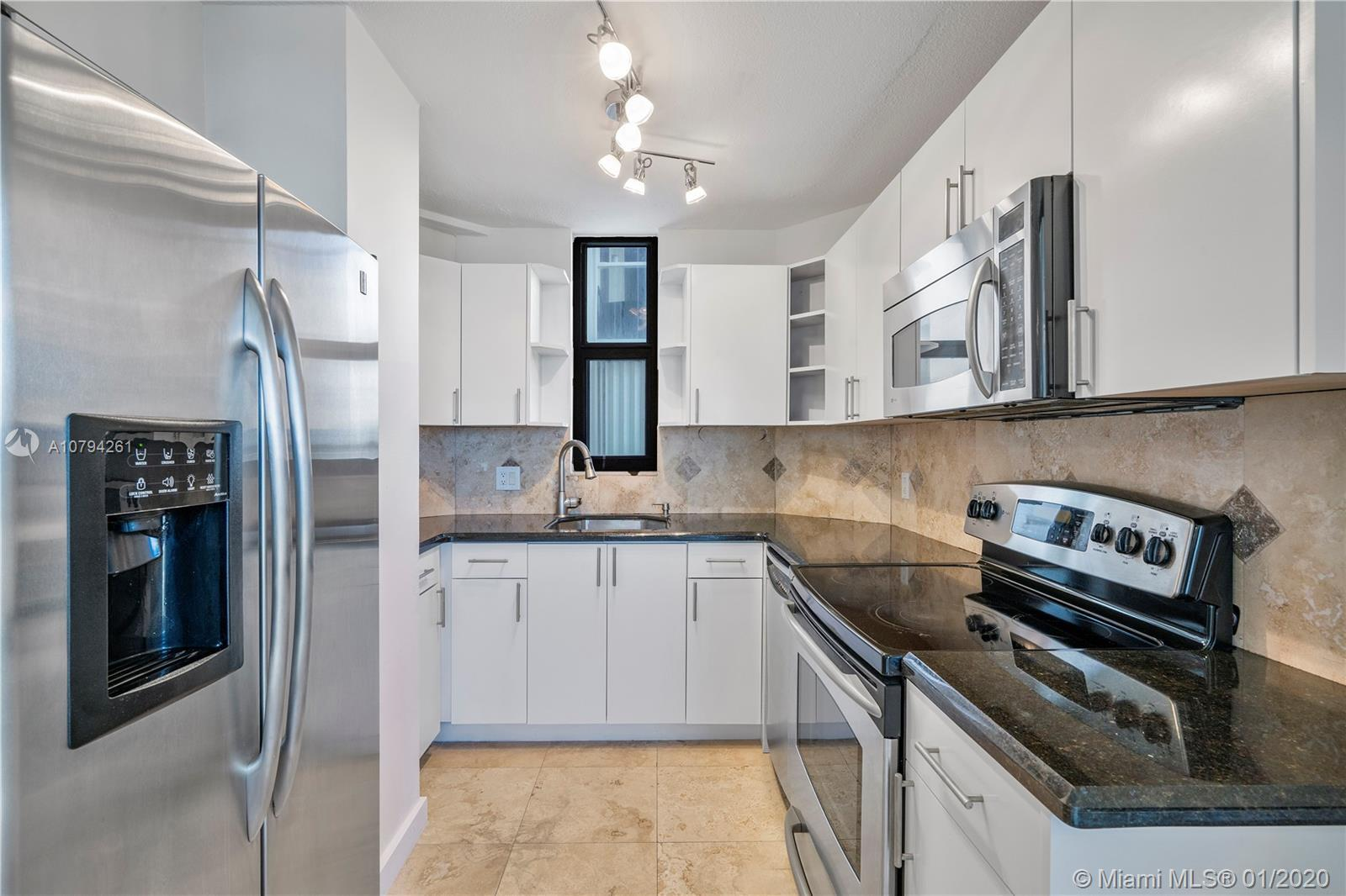 COMPLETELY REMODELED INCLUDING UPDATED BATH, KITCHEN WITH STAINLESS STEEL APPLIANCES, IMPACT WINDOWS