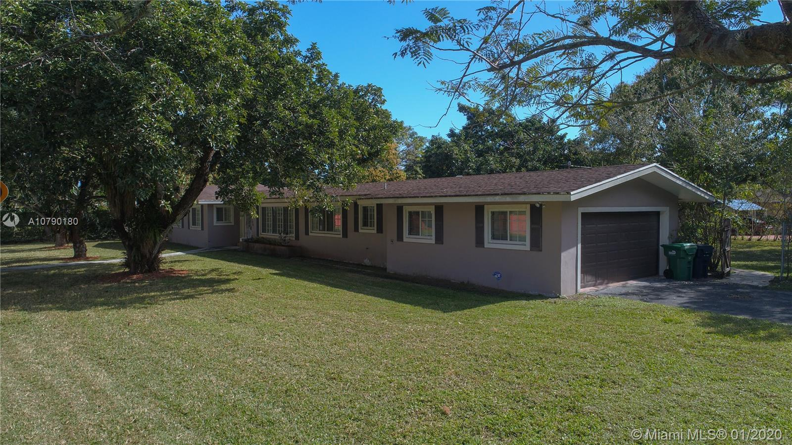 ***REDUCED*** A rare fixer-upper in prime Pinecrest location! Situated on a half-acre corner lot on