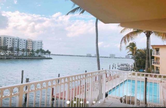 2 bedroom 2 bath remodeled unit over looking the North Bay Village stunning bay from open balcony. 2