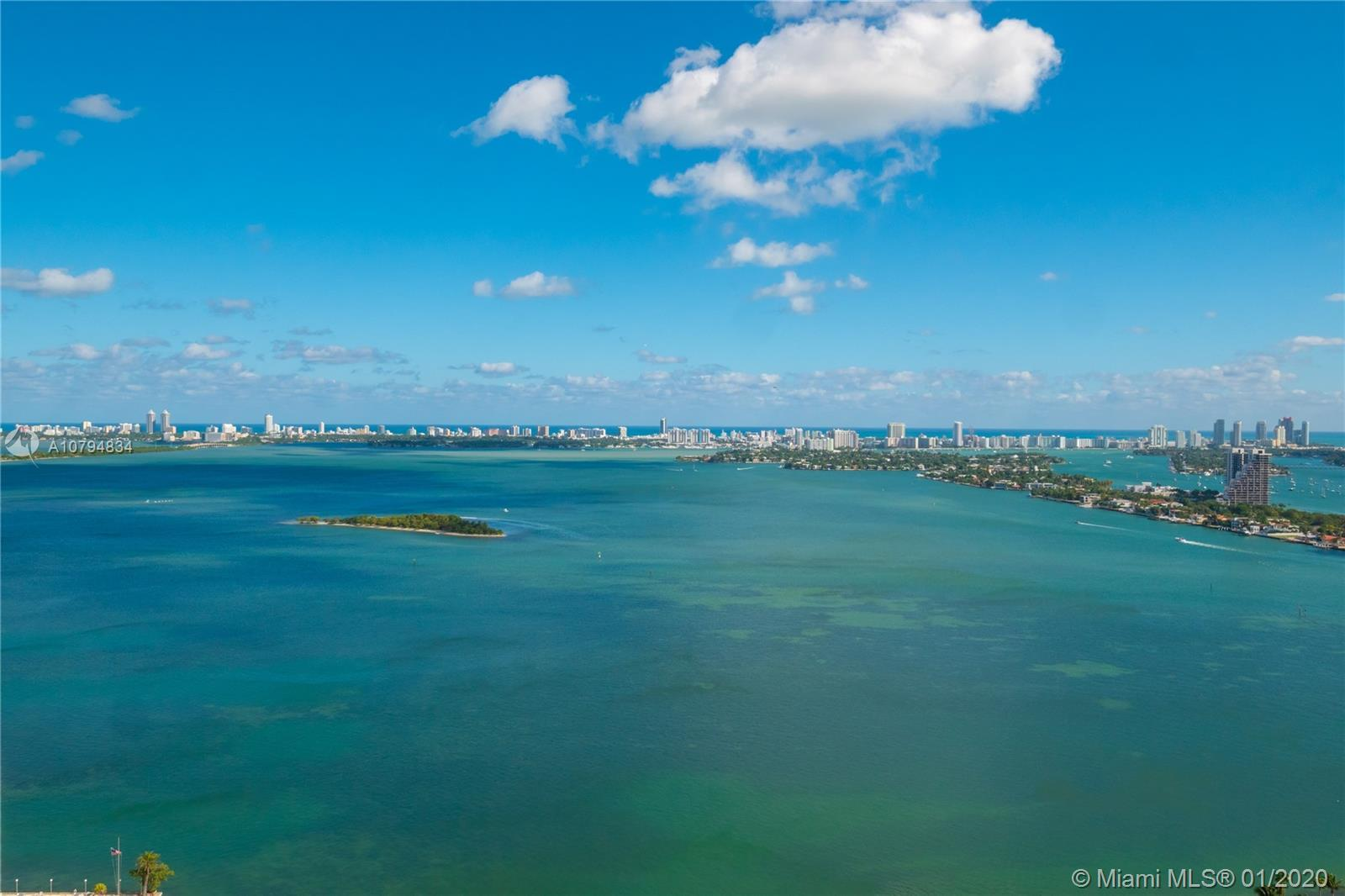CORNER UNIT WITH COMPLETELY UNOBSTRUCTED 180 DEGREE VIEWS OF BISCAYNE BAY AND THE MIAMI SKYLINE ACCE