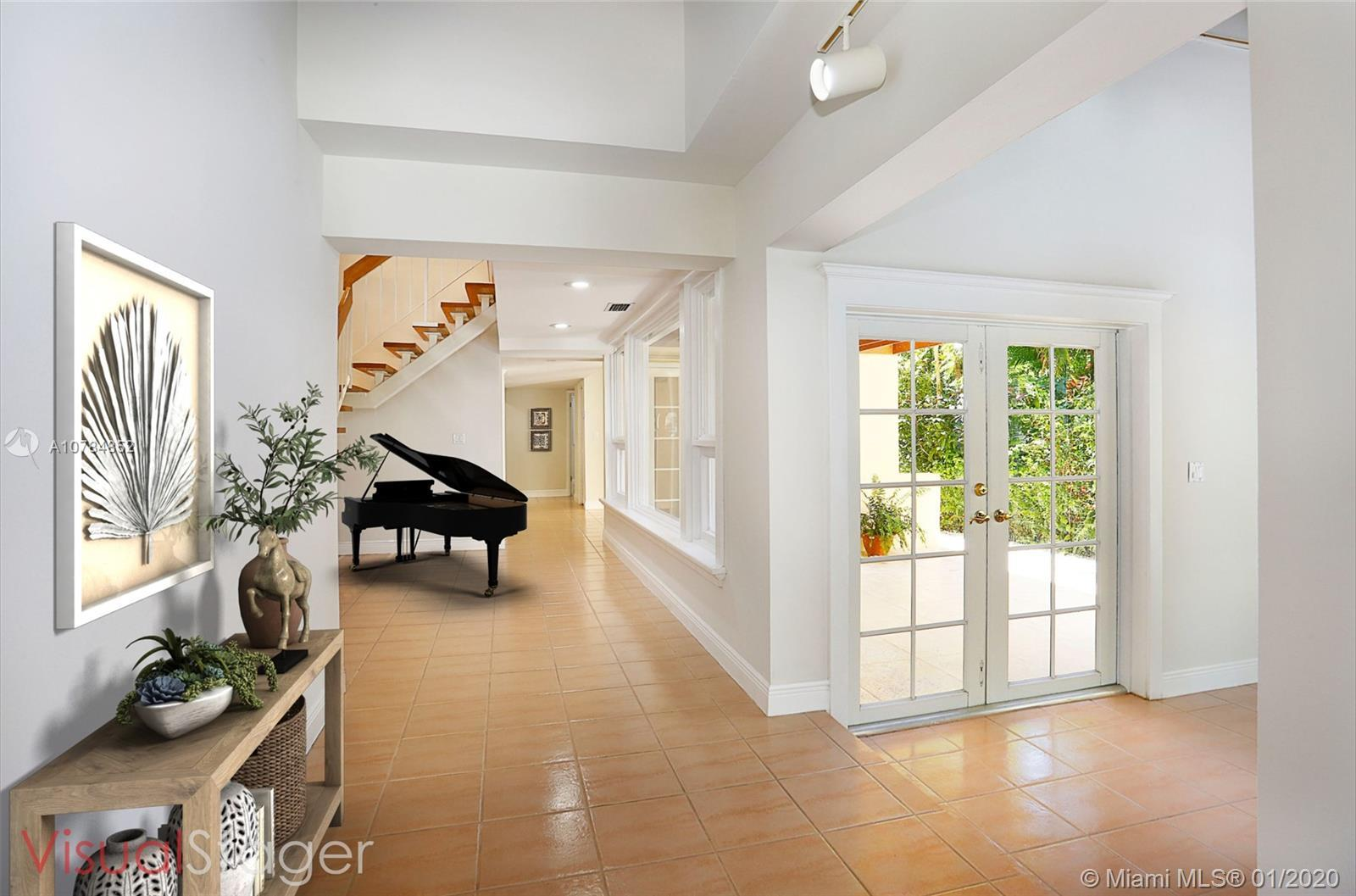 Entertainers delight! Step into a double height foyer filled with natural light leading to spacious