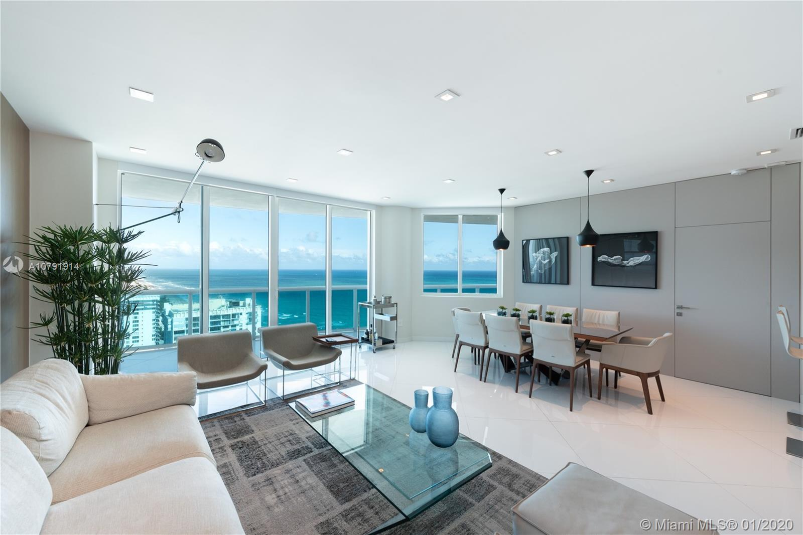 Professionally decorated and exceptionally finished - sold turnkey. Enjoy unobstructed city and ocea