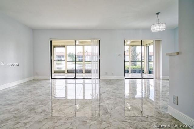 ENJOY THIS BEAUTIFUL LAKE VIEW FROM THE SCREENED IN PATIO IN THIS SPACIOUS 3 BEDROOM, 2 BATH FIRST F