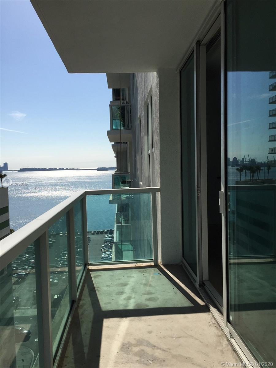 Amazing corner unit 2B/2B, unobstructed bay, and ocean views with large extended balcony. This beaut