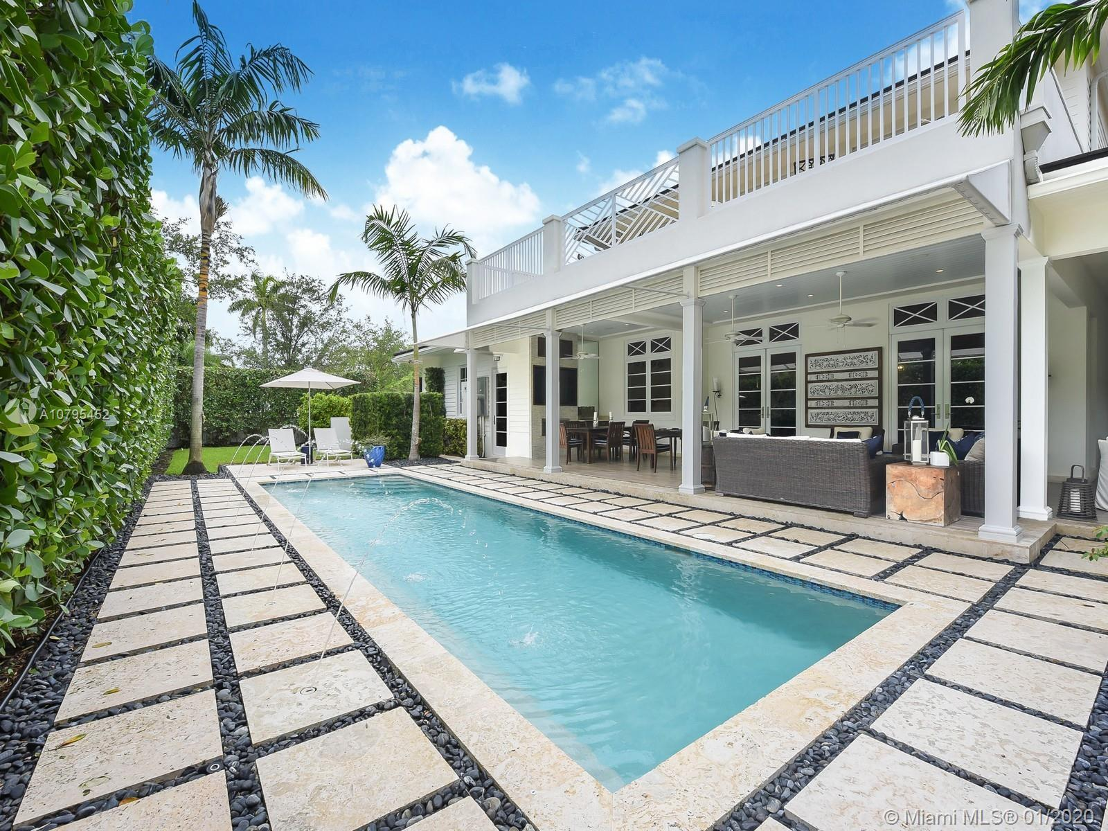Exquisitely done, ready to move in SMART home on a stunning 11900 SF CORNER lot in South Gables. Bui