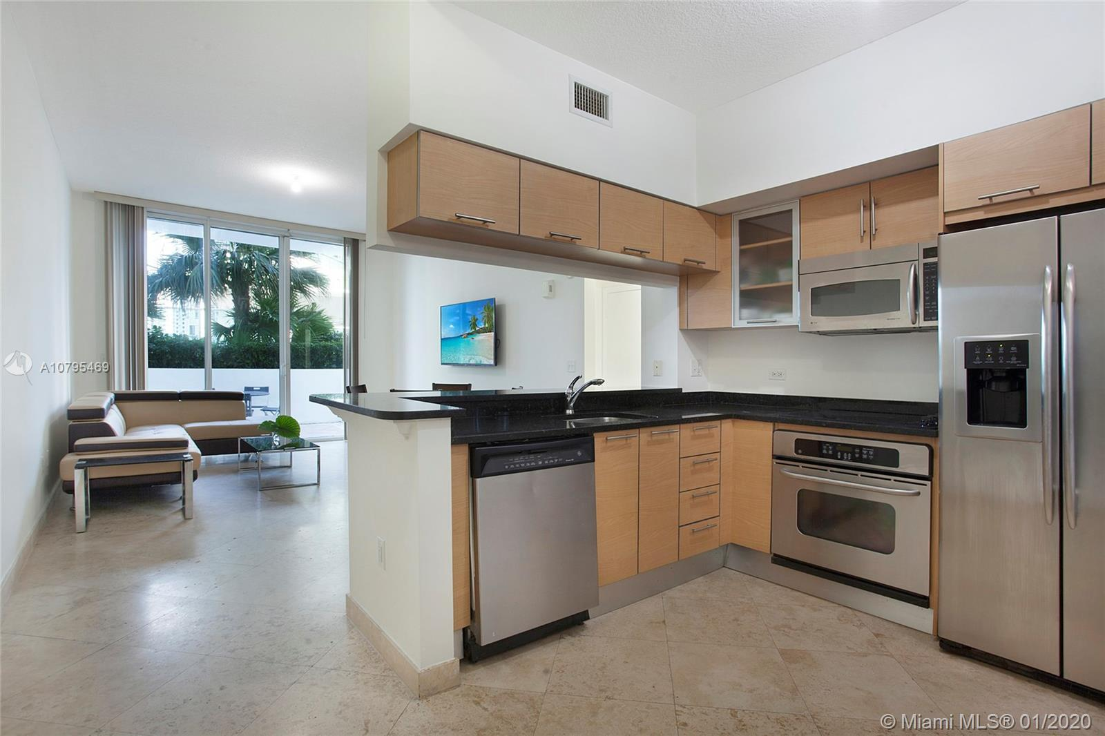 Spectacular CORNER unit with large private terrace on pool level. Beautiful 2 bedroom 2 bath in the