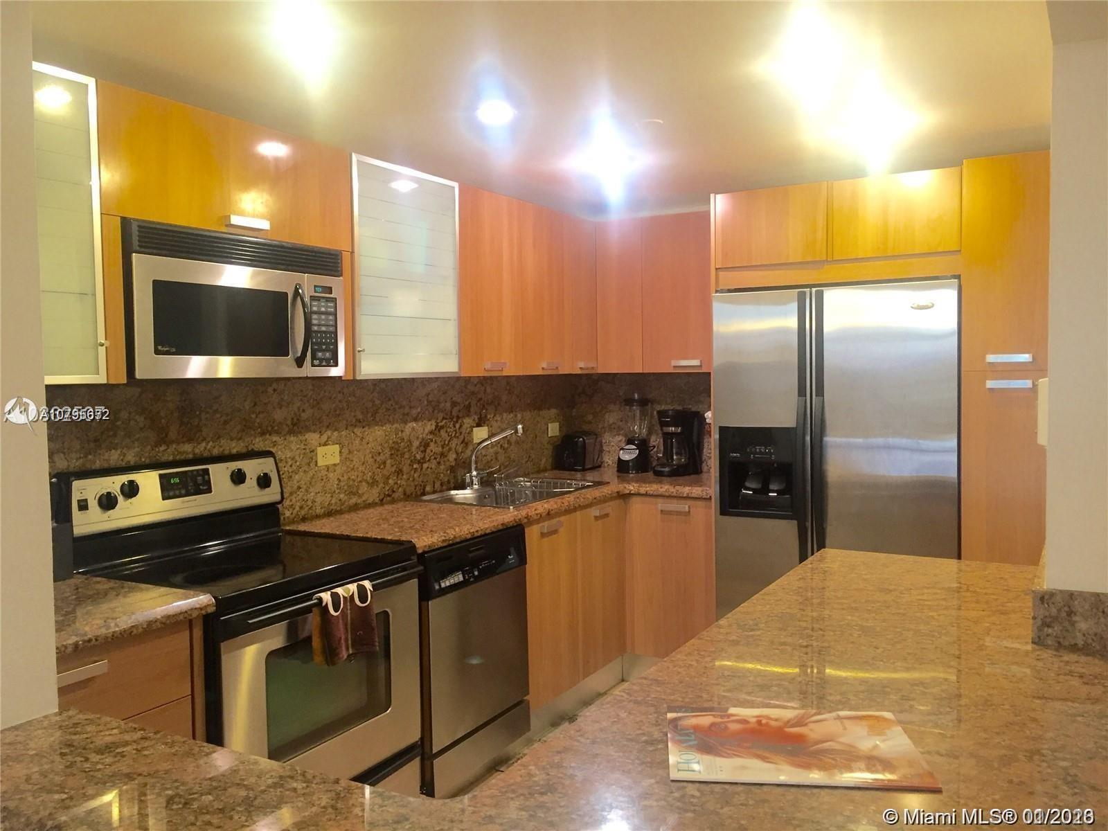 Beautifully remodeled corner unit with an open layout featuring a new Kitchen, stainless steel appli