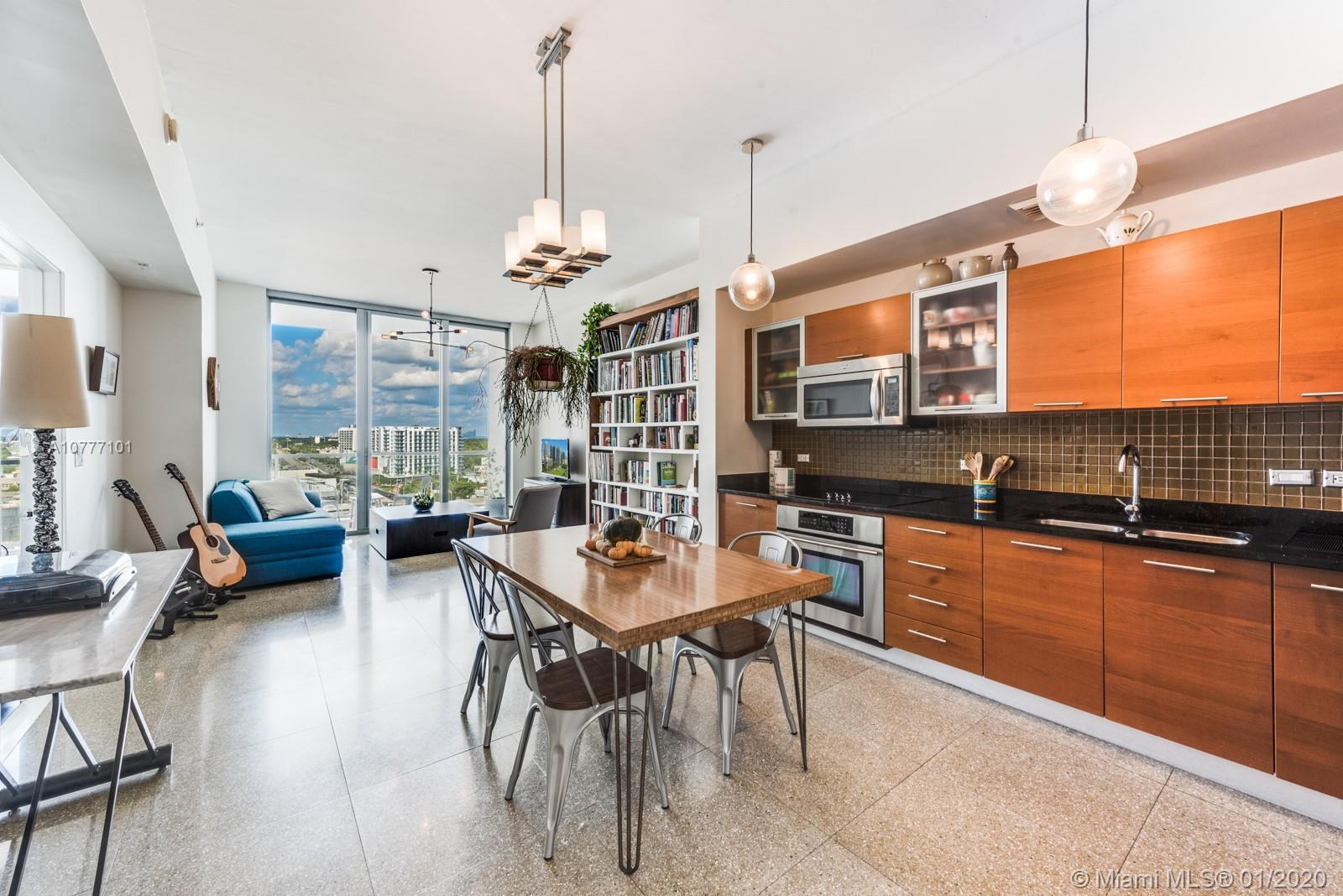 Stylish 1 Bed/1.5 Bath residence with bay views at coveted 2Midtown. This 12th Floor residence feat