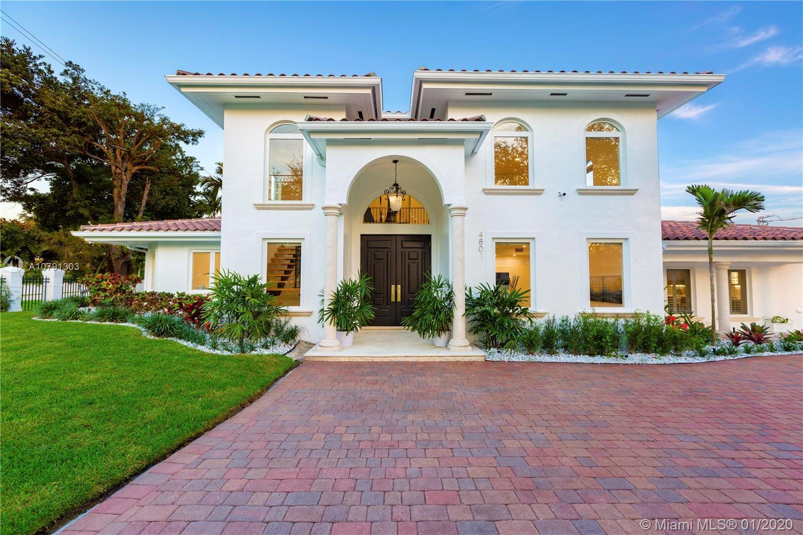 Stately Waterfront Villa on the desirable Coral Gables Waterway only blocks from the Riviera Golf Cl