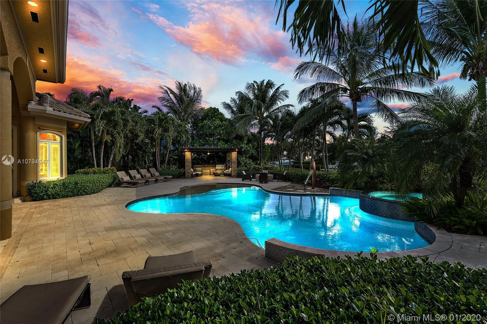 Beautiful waterfront estate with over a hundred feet of water frontage in the prestigious Admirals C