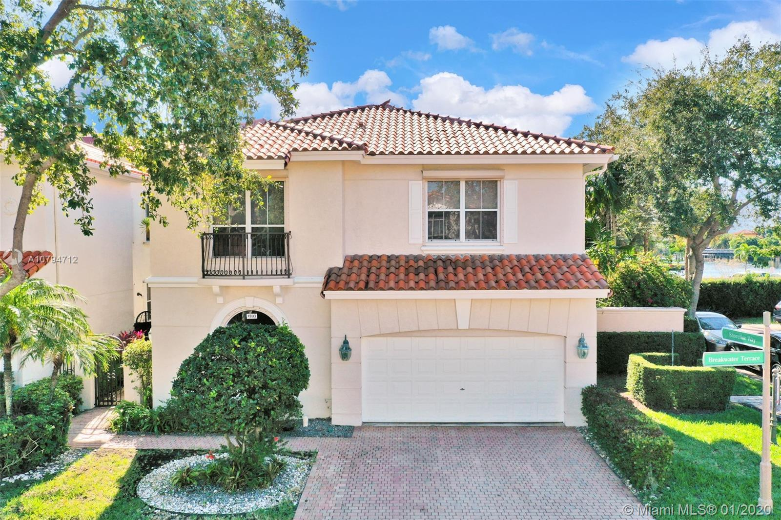 Located on a quiet tree lined street in the gated neighborhood of Harbor Islands, this one of a kind