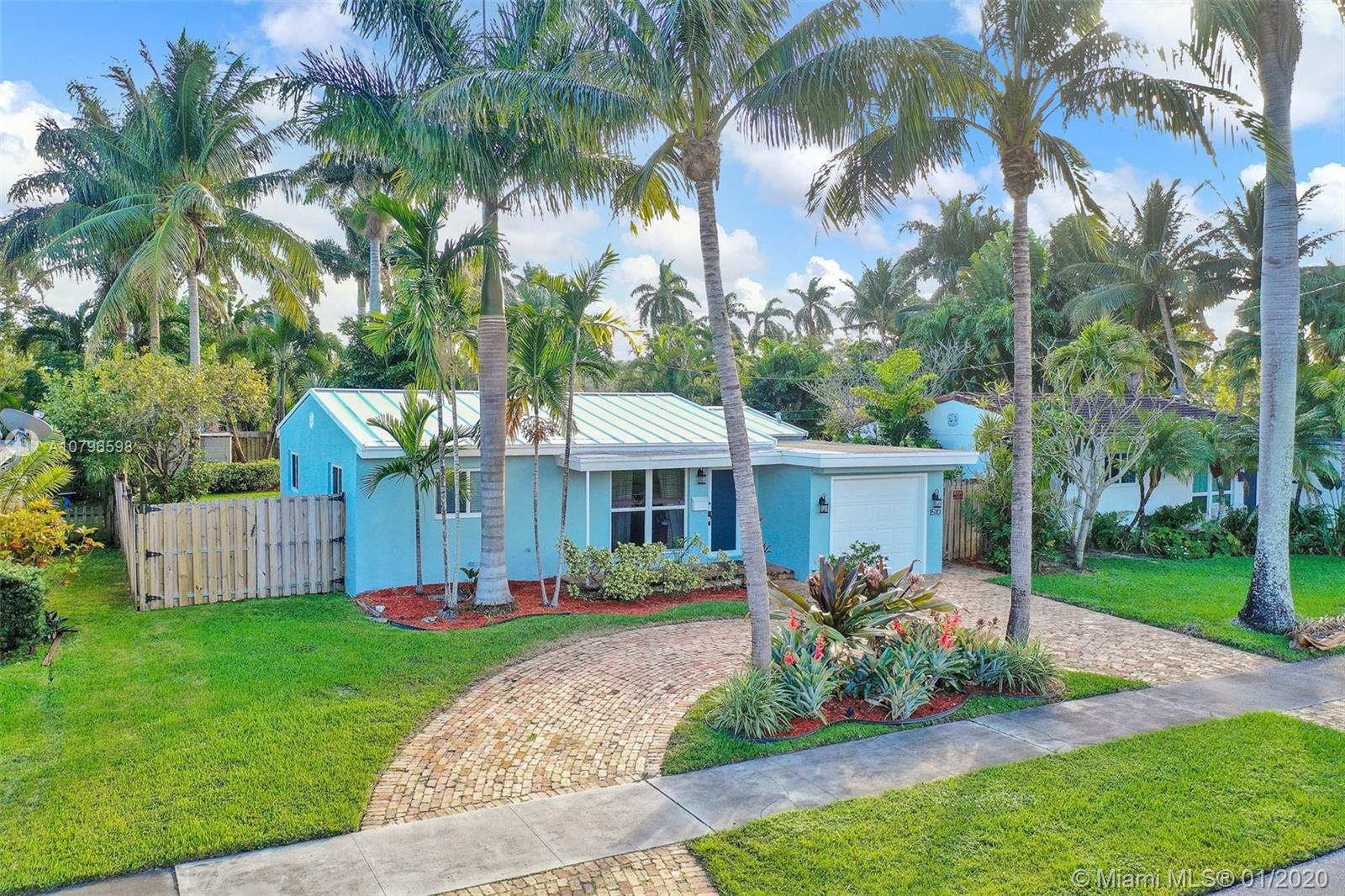 Enchanting 3/2 + Florida room home on large fenced lot. Loads of charm, impact windows & doors, meta