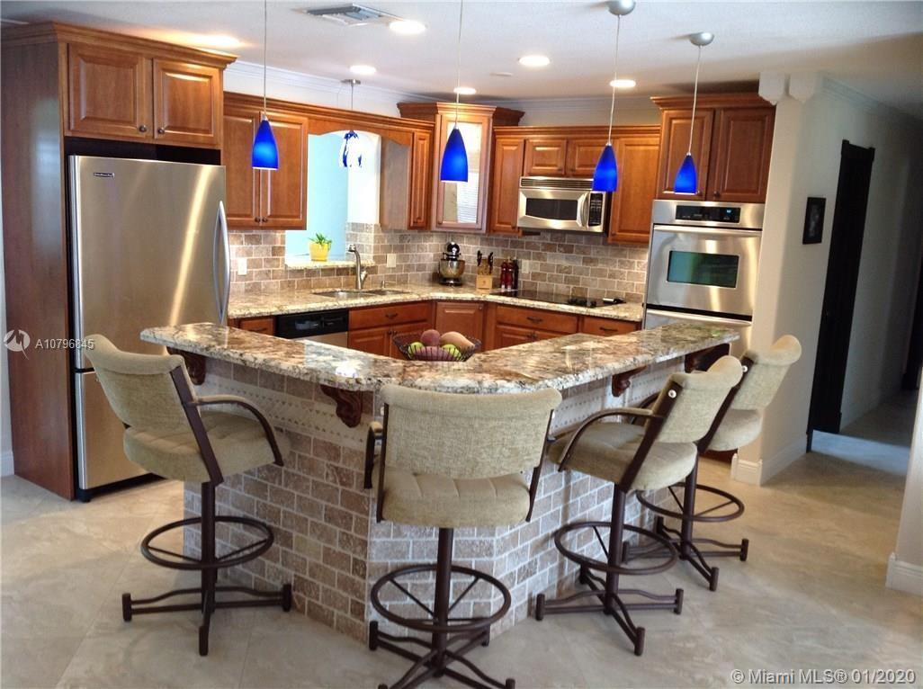 Ranch style 4/2 home on 1/4 acre lot. Open kitchen with stainless steel appliances, granite counters