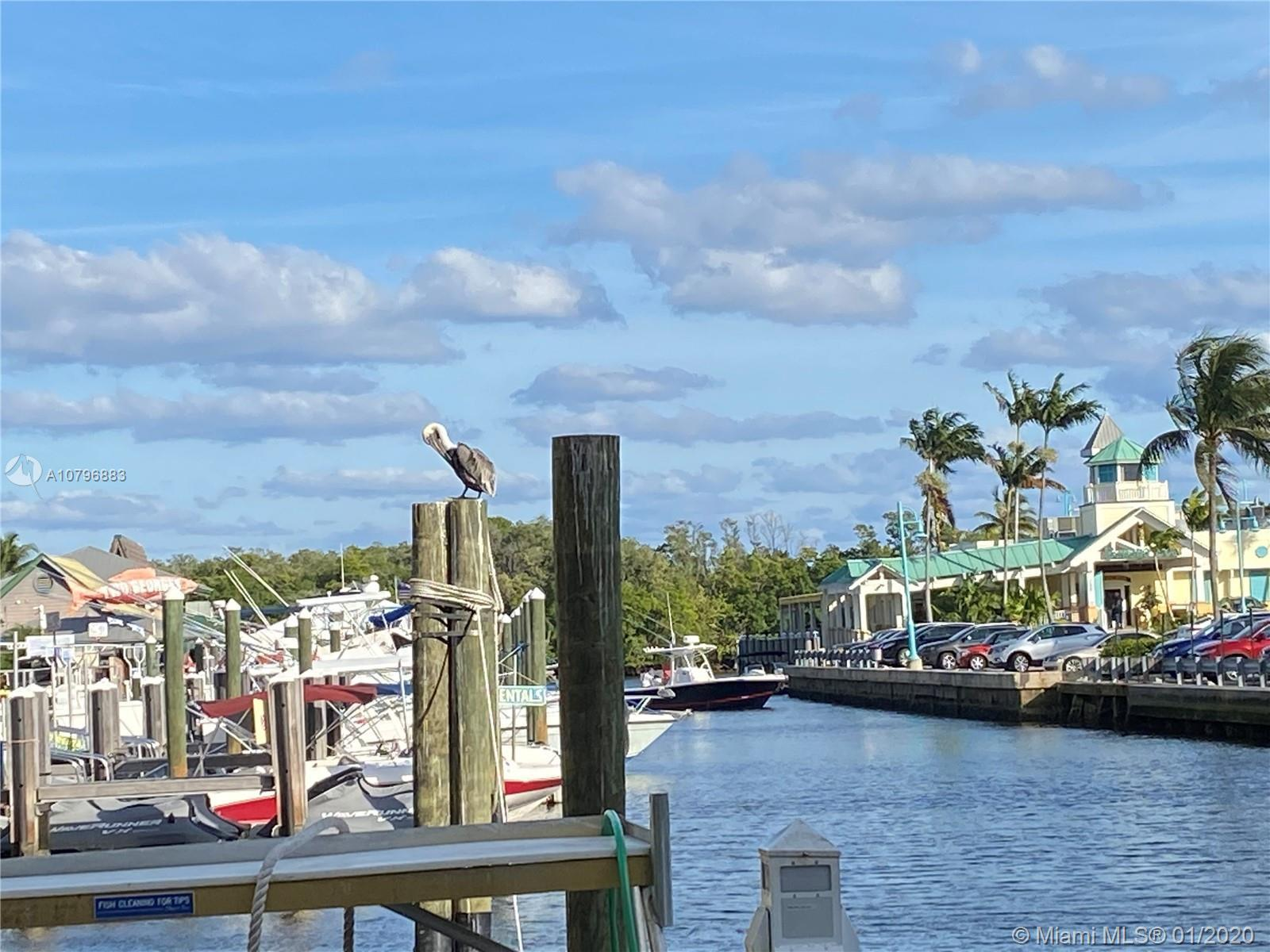 LIVE IN THE RESORT STYLE MARINA VILLAGE, UNIT 1 BEDROOM AND 1 BATH CONDO JUST STEPS AWAY FROM THE BO