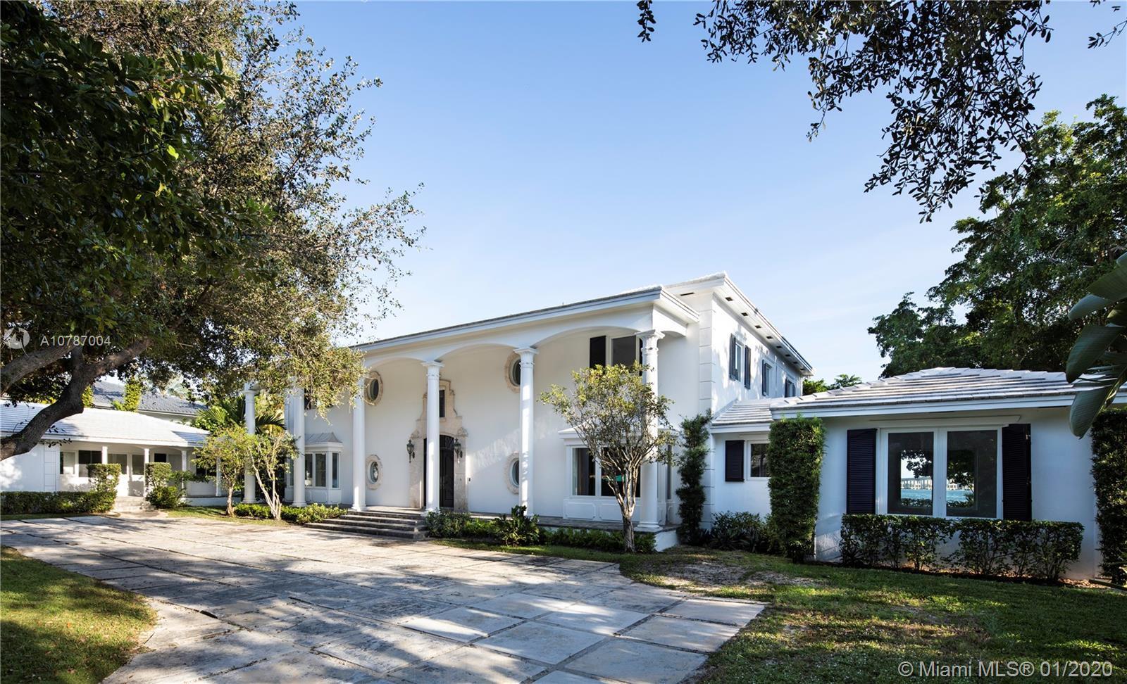 Live in a gorgeous classic bayfront 6 BR family home on over 3/4 of an acre and water frontage. The