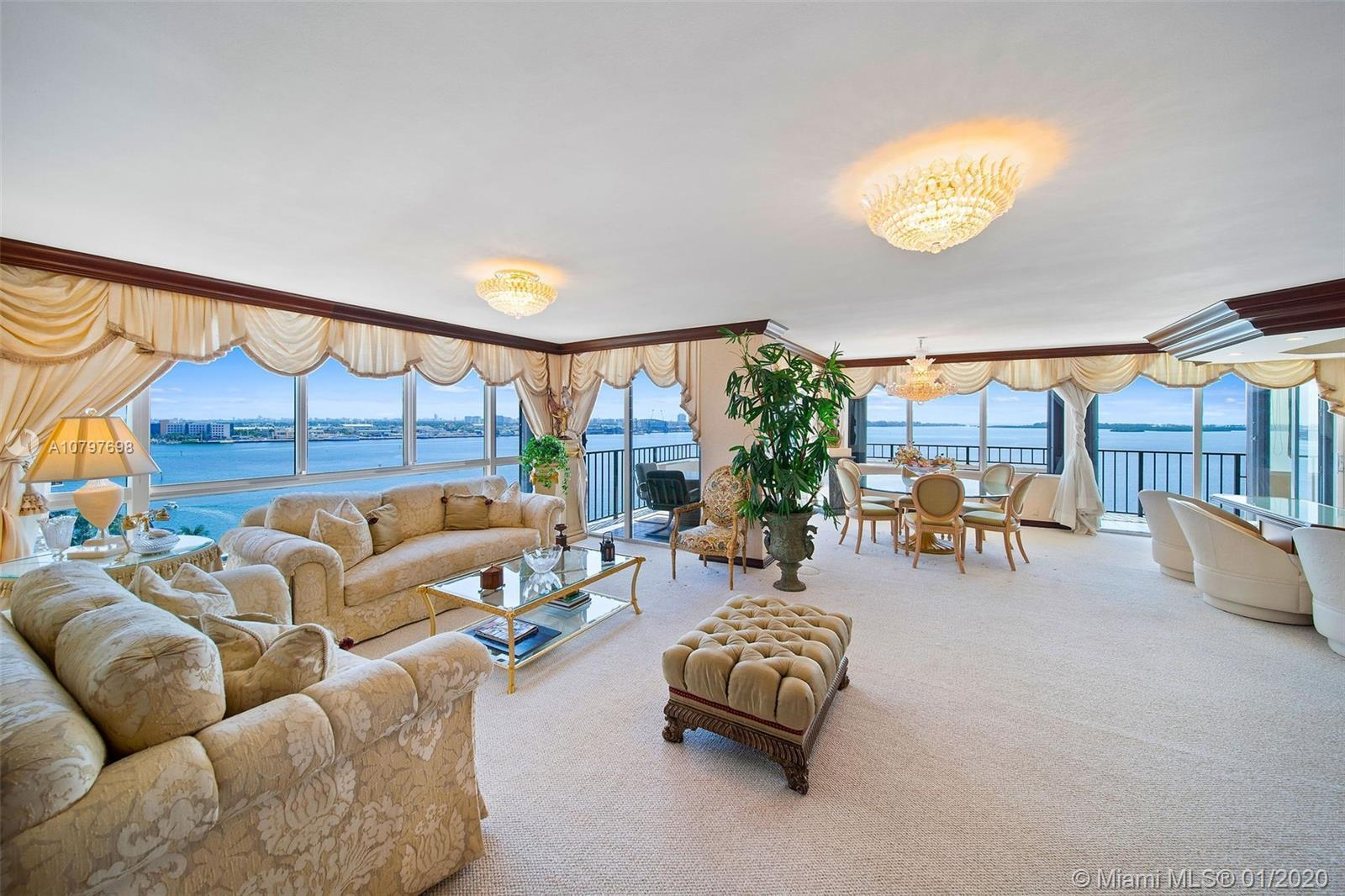 Direct waterfront views from one of the largest residences in Brickell Key. Interior has 3300 SF of